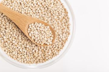 Quinoa grains in bowl isolated on white background, Chenopodium quinoa