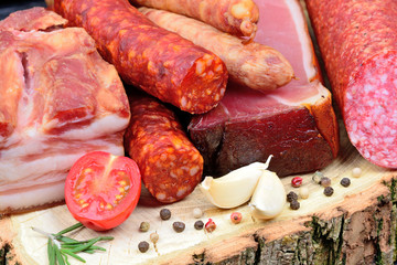 Variety types of sausages on a wood board