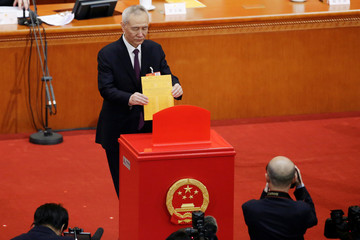 Liu He casts his ballot during the seventh plenary session of the National People's Congress (NPC)