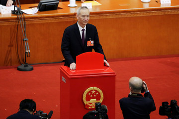 Liu He pauses after casting his ballot during the seventh plenary session of the National People's Congress (NPC)