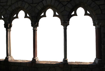 An archway window design from the side of an old building.