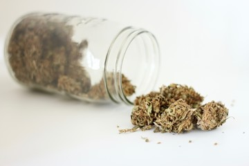 Weed, marijuana coming from a jar