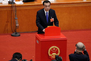 Chinese Premier Li Keqiang casts his ballot at the seventh plenary session of the National People's Congress (NPC)