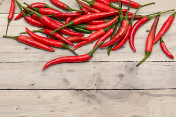 Red Hot Chili Peppers over wooden background.