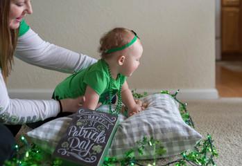Family at home celebrating St. Patrick's Day