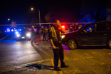 Police maintain a cordon near the site of a reported explosion in southwest Austin