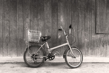 Black and white old bicycle leaning against wall
