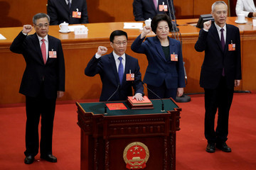 Newly elected Vice Premiers Hu Chunhua, Han Zheng, Sun Chunlan and Liu He take an oath to the constitution at the seventh plenary session of the National People's Congress (NPC)