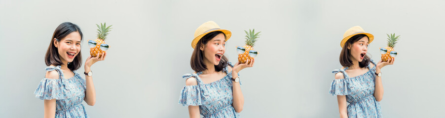 Young girl happy smile and cheerful in blue dress, hold two pineapple in hand. Concept summer travel.