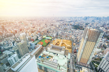 Asia business concept for real estate and corporate construction - panoramic modern city skyline aerial view of Ikebukuro with baseball field, construction site in tokyo, Japan