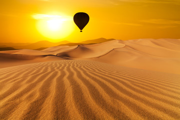 Deserts and hot air balloon Landscape at Sunrise