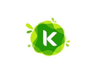 Letter K logo at green watercolor splash background. green nature logo vector