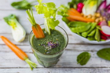 A delicious and healthy green smoothie in glass.