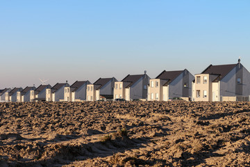 a row of newly built houses / housing development / real estate development in suburban area