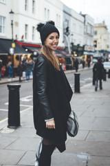 Portrait of smiling blonde woman in Portobello Road market Streets