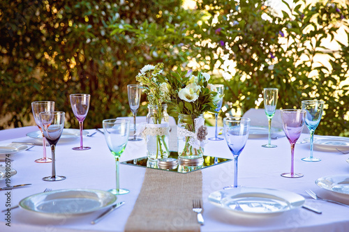 An Elegant Outdoor Table Setting For A Wedding