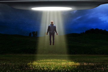 Foto auf Gartenposter UFO Ufo alien abduction