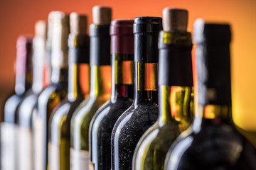 Line of wine bottles. Close-up.