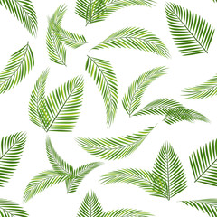 Seamless pattern.Green leaves branches of palm, trees coconut.Tropical vector background