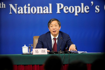 Yi Gang, deputy governor of the People's Bank of China (PBOC), attends a news conference on the sidelines of China's National People's Congress (NPC) in Beijing