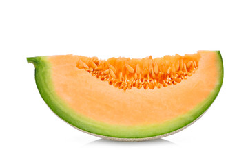sliced japanese melons, green melon or cantaloupe melon with seeds isolated on white background