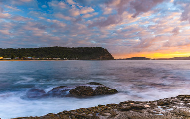 Sunrise Seascape with Clouds and Rock Platform