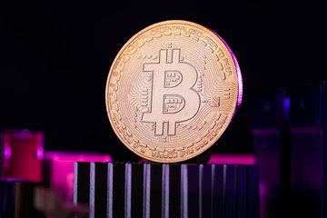 Photo of virtual currency, bitcoin and processor on pink background