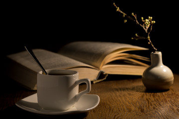 A cup of coffee and a book on the table
