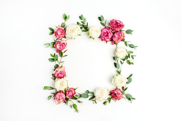 Floral frame wreath made of red and white rose flowers and eucalyptus branches. Flat lay, top view mockup with copy space.