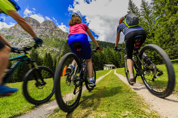 Wall Mural - Mountain biking family with bikes on track, Cortina d'Ampezzo, Dolomites, Italy
