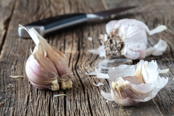 Ripe garlic head on wooden table