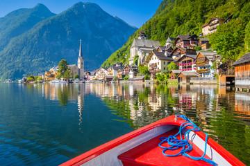 Hallstatt with traditional boat in summer, Austria