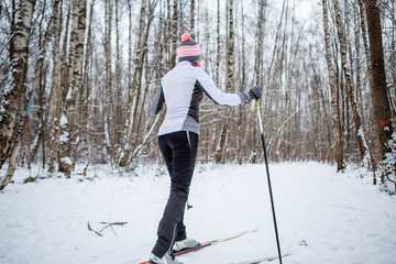 Photo of female skier in white jacket