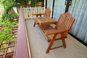 Obraz Couple of wooden chairs at balcony terrace on second floor outside the room - fototapety do salonu