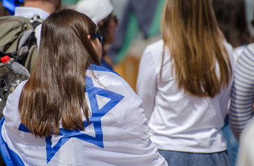 The patriotic girls wrapped in Israeli flags celebrate Israel Independence day