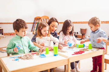Children play with kinetic sand