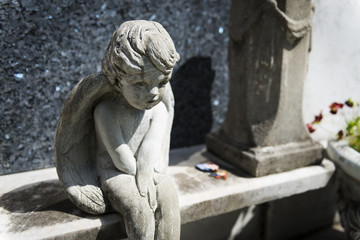 Detail of a tomb with a sad angel at the Lafayette Cemetery No. 1 in the city of New Orleans, Louisiana, USA