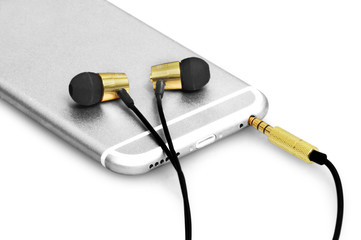 Premium black and golden earphone attached in a silver elegant phone. Perfect for listening and controlling your phone with this headphone.
