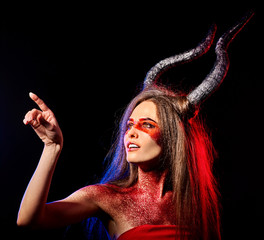 Mad satan woman on black magic ritual of hell. Witch reincarnation mythical creature Sabbath. Astral travel. Zodiac Capricorn Aries. Make-up for night club for demon inflicts damage.