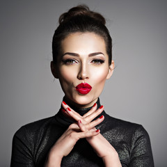 Girl's face with kiss gesture.