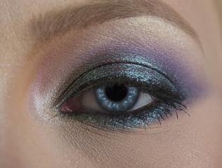 Eye, beautiful blue. Macro image of human eye. Insightful look blue eyes girl. Female face macro, close up blue. Close up photo of woman blue eye with make-up. Beautiful makeup, eye cosmetics