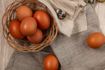 chicken eggs with willow branches with textile. Springtime. Top view