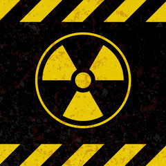 Sign of radiation. A plate in the style of grunge. Vector illustration