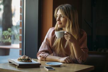 Woman Enjoying Drinking Coffee