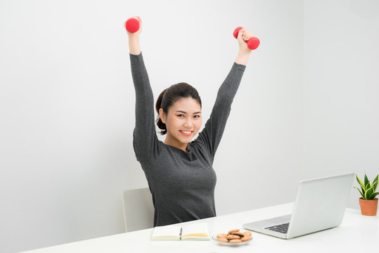 Business woman working and workout at her office