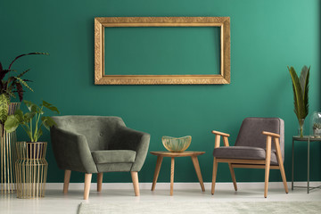 Retro armchairs in green living room