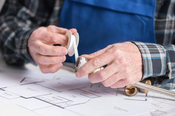 Plumber's hands using teflon tape