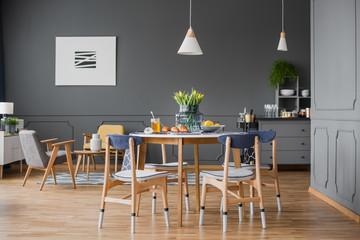 Table in grey room interior