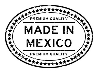 Grunge black premium quality made in Mexico oval rubber seal stamp on white background