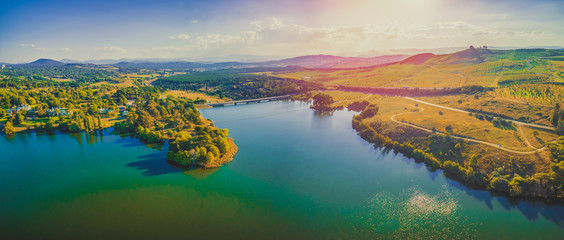 Aerial panorama of beautiful lake and countryside at sunset in Canberra, Australia